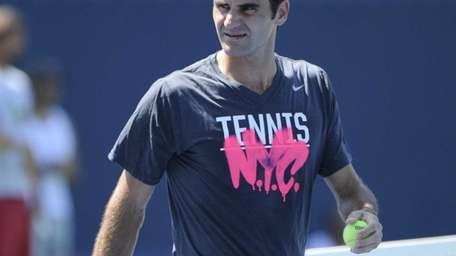 Roger Federer looks on from a practice court