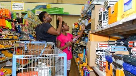 Kimora Caldwell, 9, and her mother, Xiomara, shop