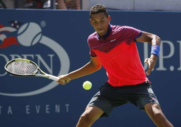 Nick Kyrgios returns a shot against Mikhail Youzhny