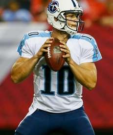Jake Locker of the Tennessee Titans drops back