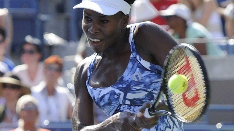 Venus Williams returns to Kimiko Date-Krumm during the