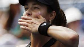 Ana Ivanovic, of Serbia, blows a kiss to