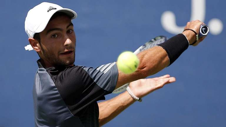Noah Rubin lines up a backhand in a