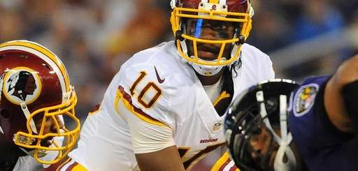 Washington Redskins quarterback Robert Griffin III waits for