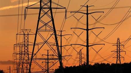 Transmission towers carry power lines through Suffolk County