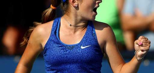 CiCi Bellis of the United States reacts against