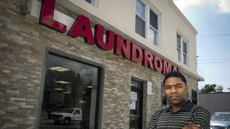 Laundromat owner Benoit Jeune outside his establishment in