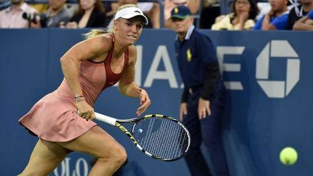 Caroline Wozniacki returns a shot to Magdalena Rybarikova