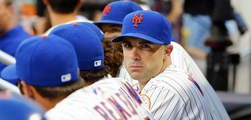 David Wright of the Mets looks on from