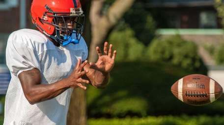 Nassau CC's Yahkee Johnson runs a drill during
