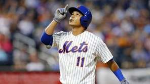 Ruben Tejada of the Mets reacts after his