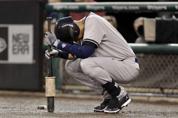 The Yankees' Derek Jeter pauses before batting against