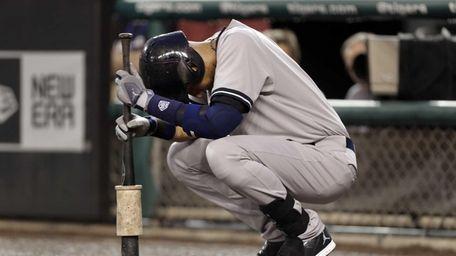 The Yankees' Derek Jeter pauses before batting against