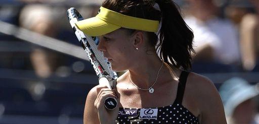 Agnieszka Radwanska, of Poland, reacts after a shot