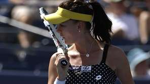 Agnieszka Radwanska, of Poland, reacts after a shot