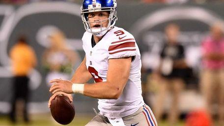 Giants quarterback Ryan Nassib looks to pass during