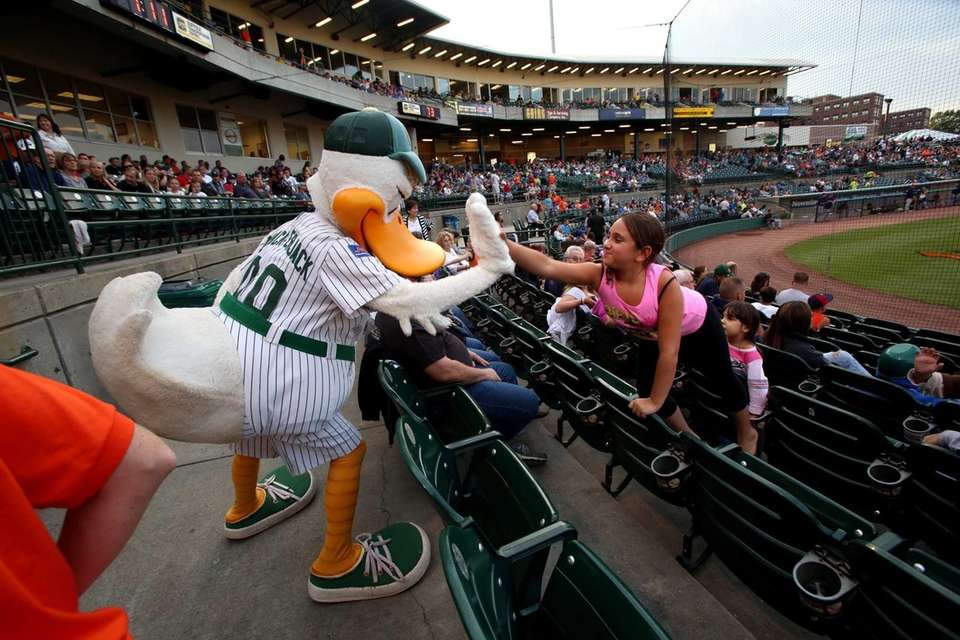 LI Ducks mascot Quacker Jack gives a high-five