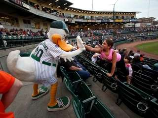 LI Ducks mascot Quacker Jack gives a high-five