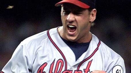 John Rocker pumps his fist after striking out