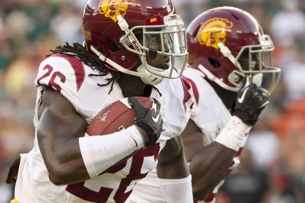 Southern California cornerback Josh Shaw, left, runs back