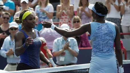 Serena Williams, left, congratulates her sister Venus after