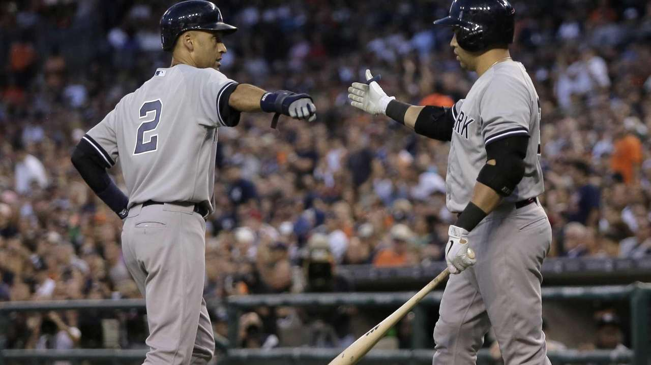 Derek Jeter of the Yankees is congratulated by