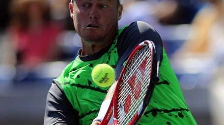 Lleyton Hewitt hits a backhand return against Tomas