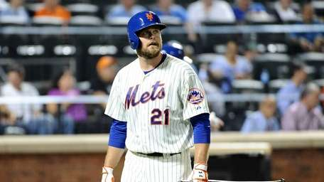 Lucas Duda of the Mets walks back to