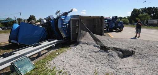 An overturned dump truck forced lane closures on