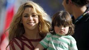 Shakira carries her son Milan after she performed