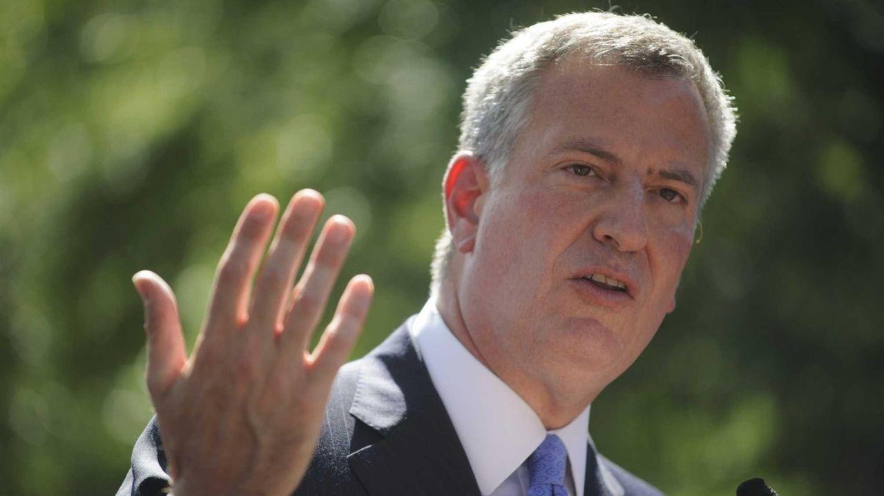New York Mayor Bill de Blasio holds a