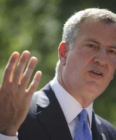 New York Mayor Bill de Blasio holds a