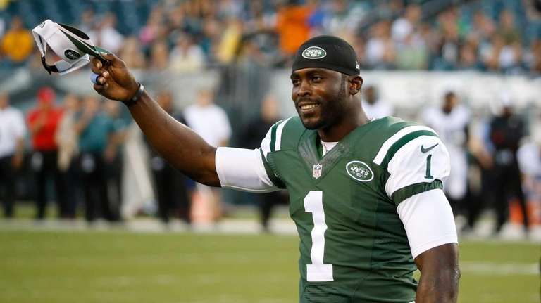 The Jets' Michael Vick acknowledges the crowd during