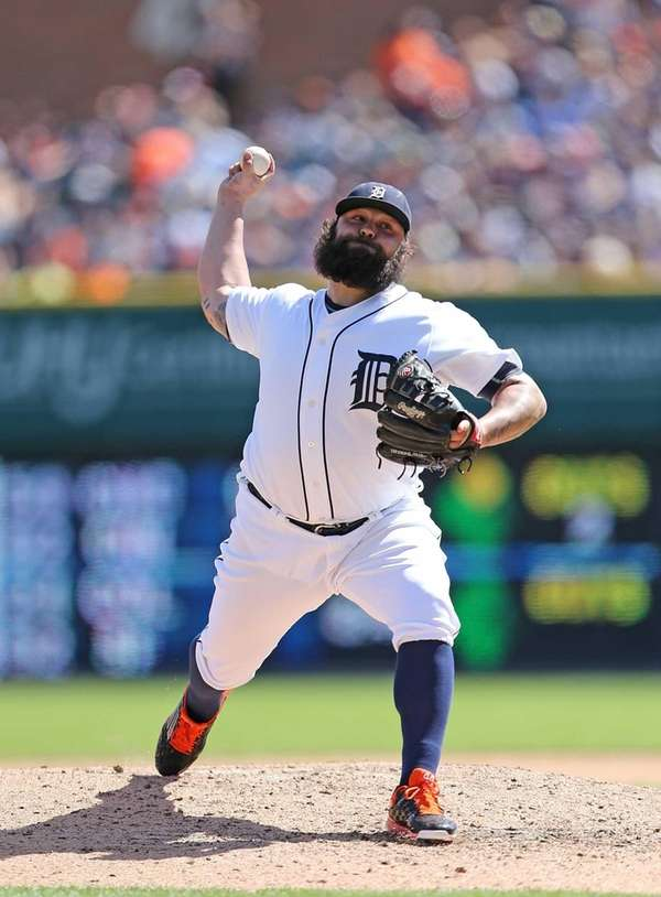 Detroit Tigers pitcher Joba Chamberlain delivers a pitch