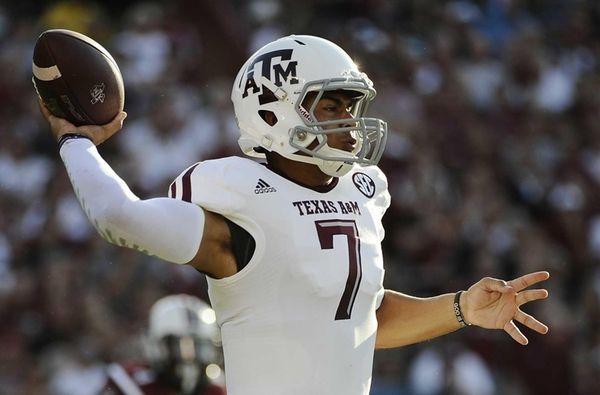 Texas A&M quarterback Kenny Hill (7) throws against