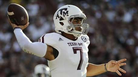 Texas A&M quarterback Kenny Hill (7) throws against