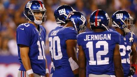 The Giants' Eli Manning looks on against the