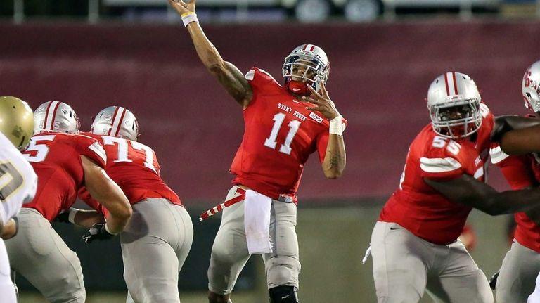 Stony Brook quarterback John Kinder unloads a 61-yard