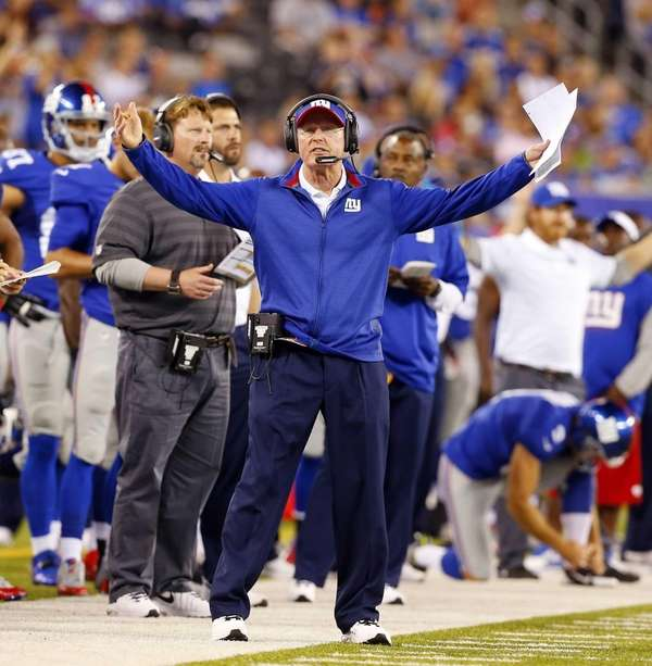 Head coach Tom Coughlin of the Giants reacts