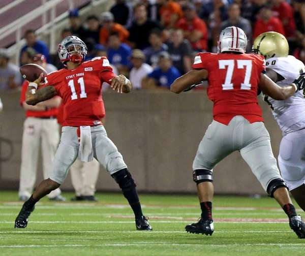 Stony Brook quarterback John Kinder looks to go