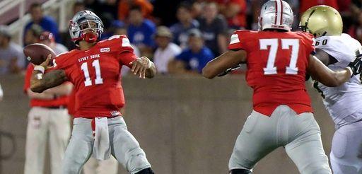 Stony Brook quarterback John Kinder looks to go