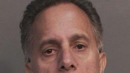 Michael F. Arbassio, 57, of Hicksville, was arrested