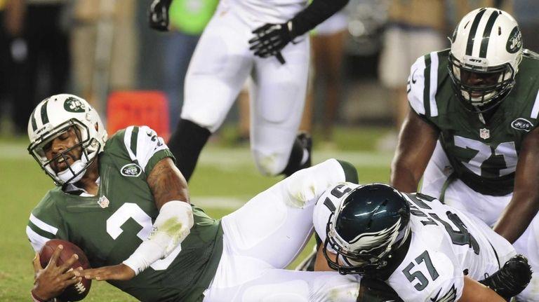 Quarterback Tajh Boyd of the Jets is sacked