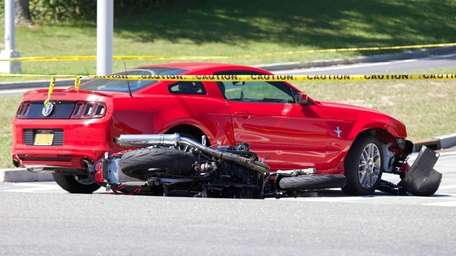 A motorcycle and car collided near the south
