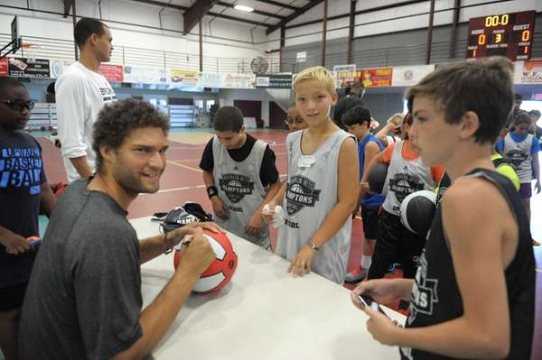 Nets center Brook Lopez signs autographs for youngsters