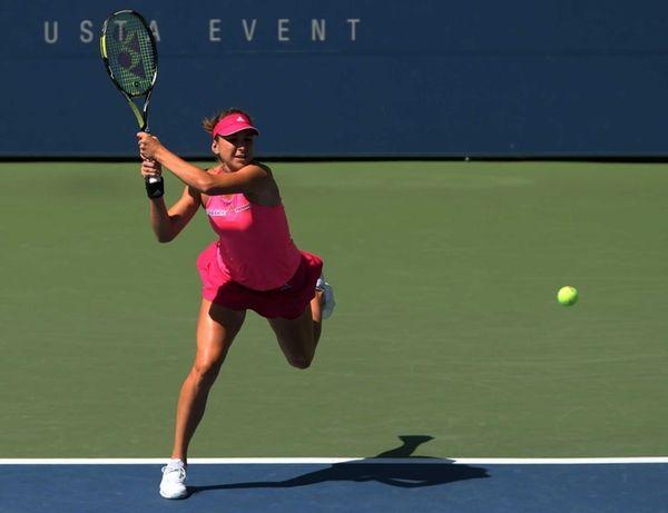 Belinda Bencic returns a shot to Angelique Kerber
