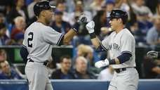 Jacoby Ellsbury of the Yankees is congratulated by