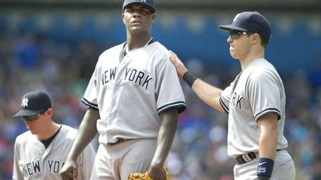 Yankees' starting pitcher Michael Pineda stands on the