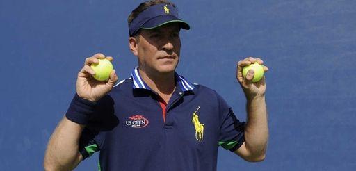 U.S. Open ballperson Chris Bustamante holds up tennis