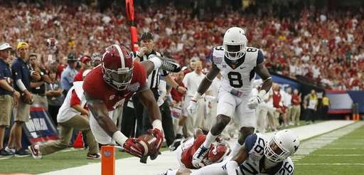 Alabama running back T.J. Yeldon dives into the